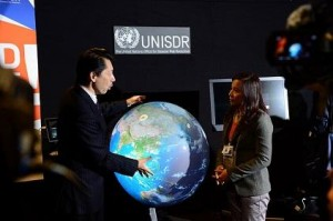 The science of disaster risk reduction in action: the interactive Tangible Earth dynamically maps risk-relevant aspects of the planet, such as real-time weather, earthquakes and tsunami, climate variations and global warming progression (Photo: UNISDR)