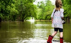 Young Girl on a flooded Street